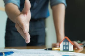 Sharrett Construction How To Hire Best General Contractor - man reaching for handshake